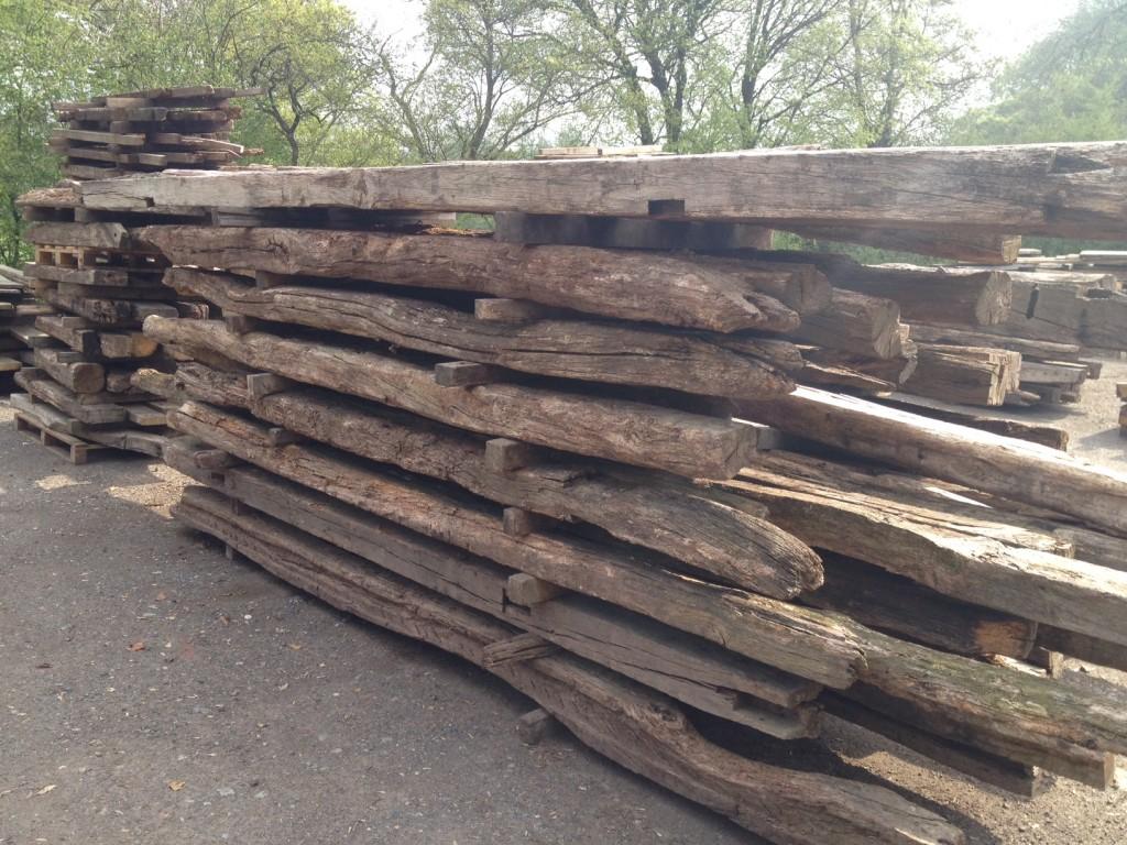 reclaimed oak beams in yard in sussex
