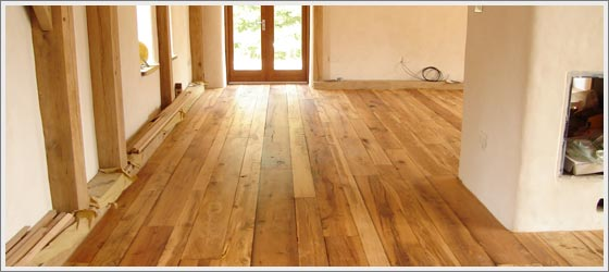 a image of reclaimed wood flooring in cottage