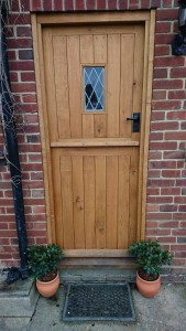 Solid oak stable door with diamond leaded light