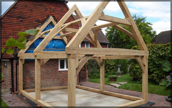 Oak framed porches barns porches oak framing for Oak framed house designs