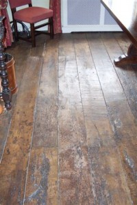 dark wood flooring from reclaimed oak with a chair on it