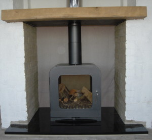 oak mantel above wood burner