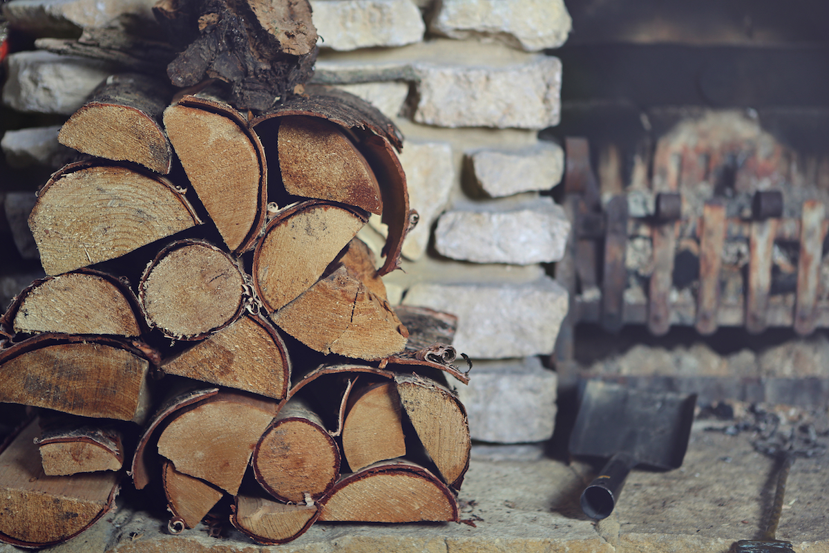 logs next to fireplace